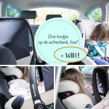 Drie kinderen in autostoelen op de achterbank